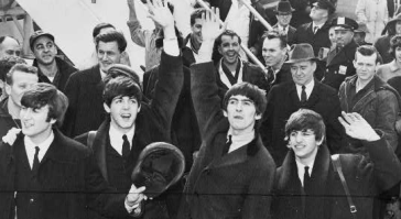 The Beatles at Kennedy Airport, February, 1963 via wikimedia commons