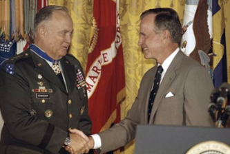 HWBush in a tan suit